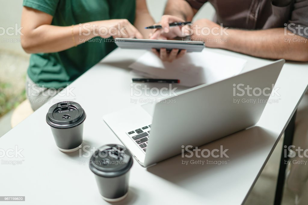 Working in office on a project. stock photo
