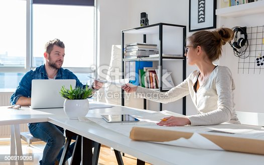 511979840 istock photo Working in office 506919098