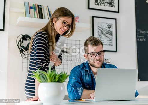 511979840istockphoto Working in office 508142698