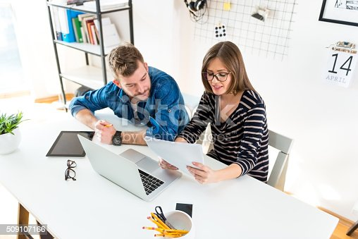 511979840istockphoto Working in office 509107166
