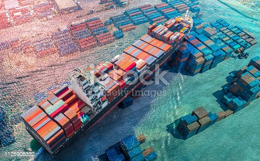 aerial view of the vessel ship carrier of the containers services to worldwide international sailing over the shipment of units containers in the sea, CONCEPT logistics transport services