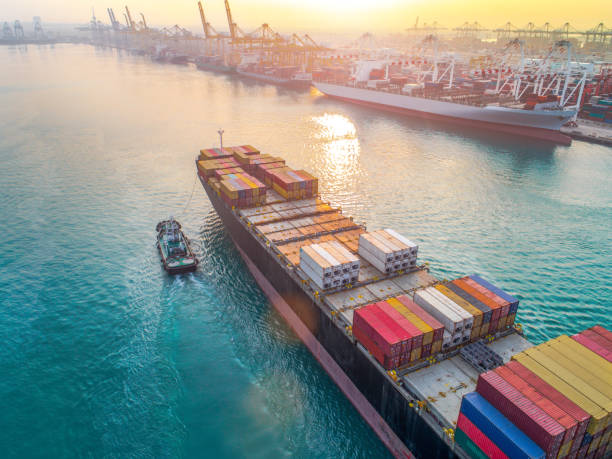 working in port terminal aerial view of containers ship vessel arrival approach to the main entrance gate od an international port, transport and logistics system services to worldwide global of seas and lands container ship stock pictures, royalty-free photos & images