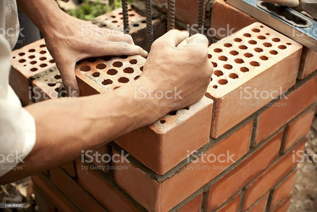 Working in progress. Bricks laying stock photo