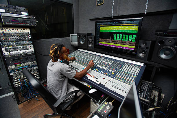 working in studio - producer stock pictures, royalty-free photos & images