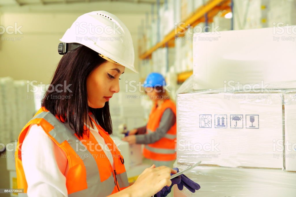 Working in warehouse checking delivery royalty-free stock photo