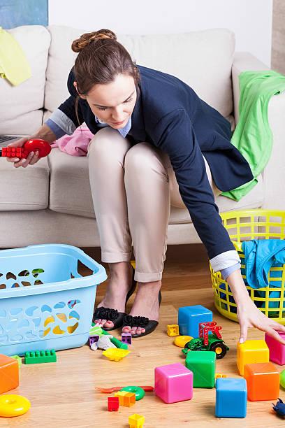 working lady cleaning up toys - superwoman barn bildbanksfoton och bilder