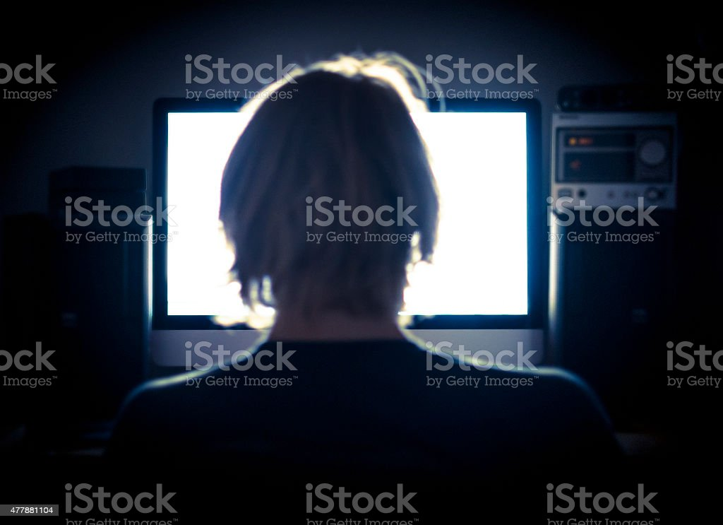 Working late at night. stock photo