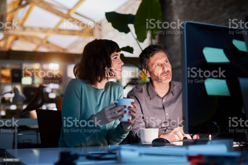 Working late in a small office in Barcelona stock photo