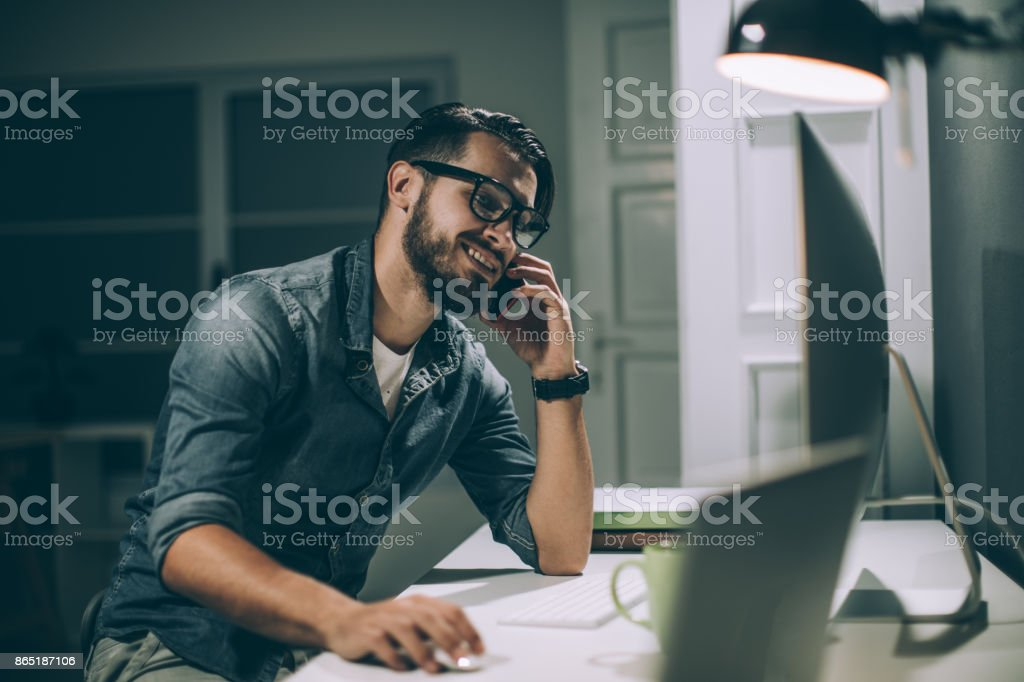 Working late in the office stock photo