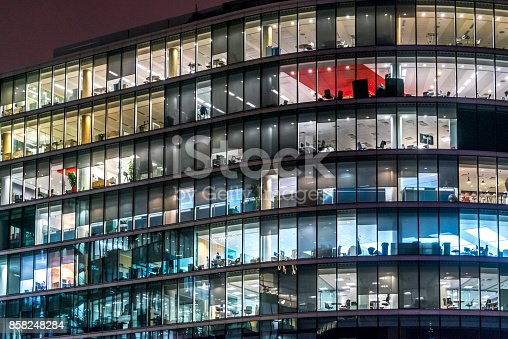 istock Working late. Office windows by night. 858248284
