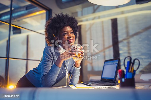 918035432 istock photo Working Late. Young woman, architect working late in office 918035472
