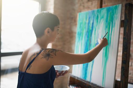 636761588 istock photo Working Magic With Her Brush 816071918