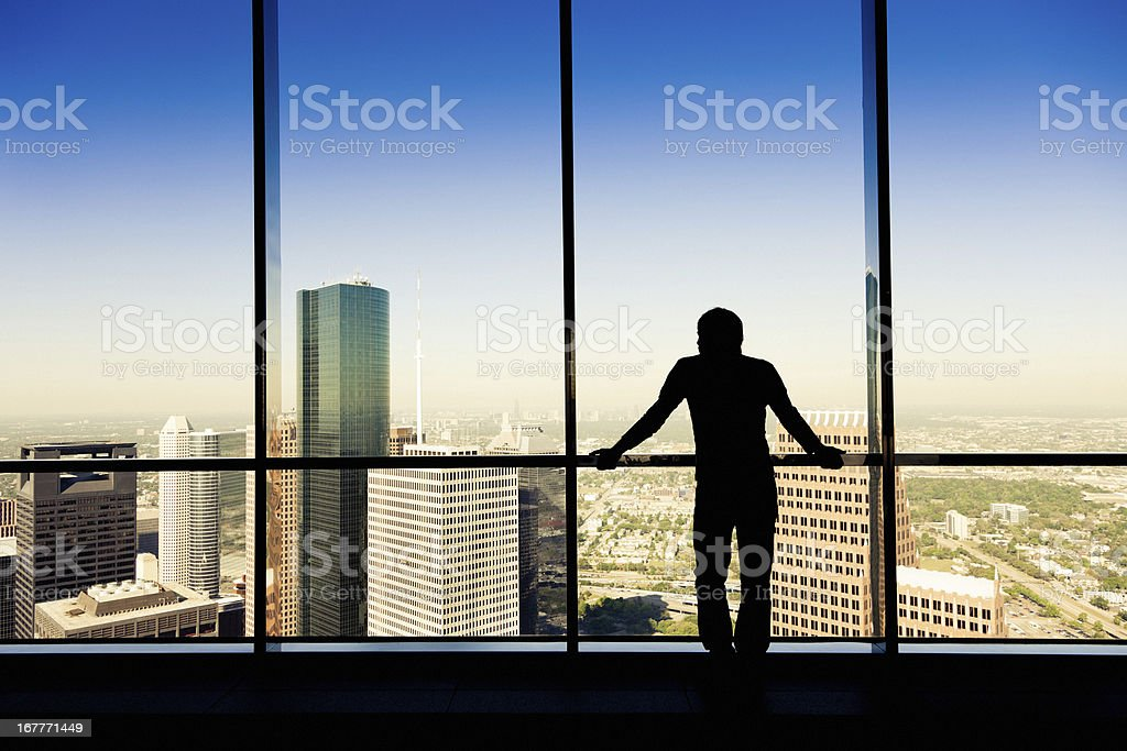Working man looking the city stock photo