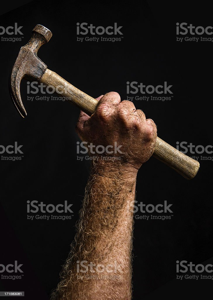 Working man's arm and hammer stock photo