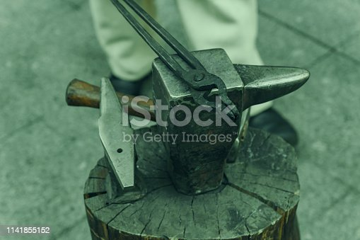 547224670istockphoto Working metal tools in blacksmith's workshop, close-up, selective focus, toned 1141855152