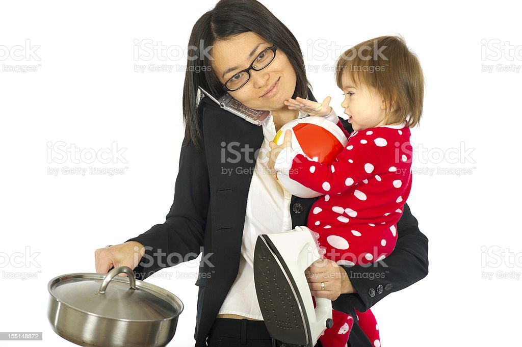 Working mom juggles a child and household chores royalty-free stock photo