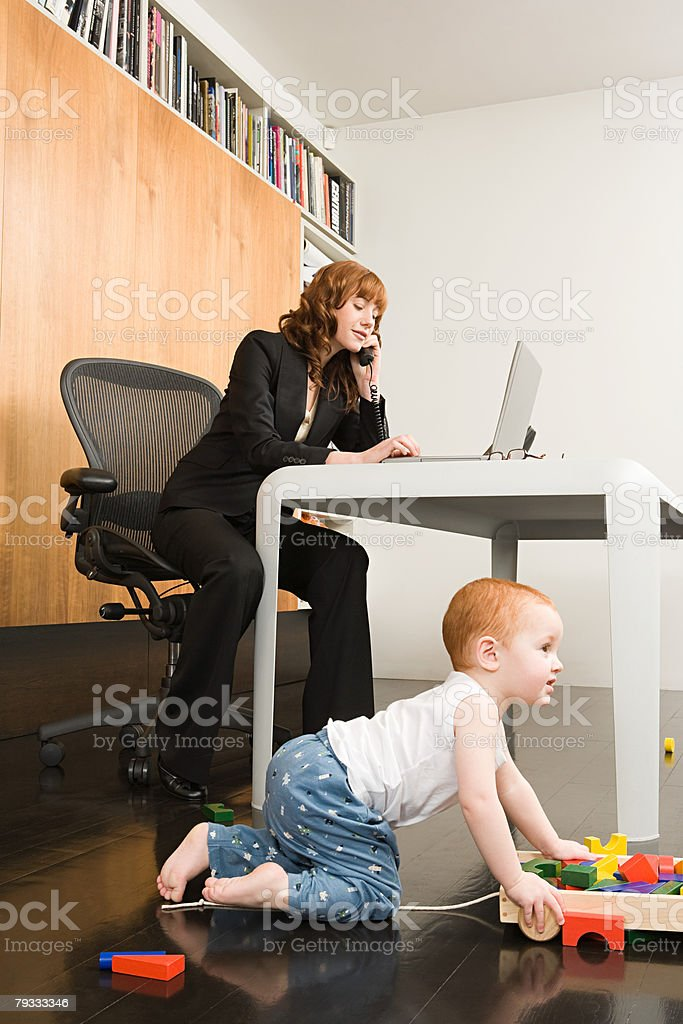 A working mother multitasking 免版稅 stock photo