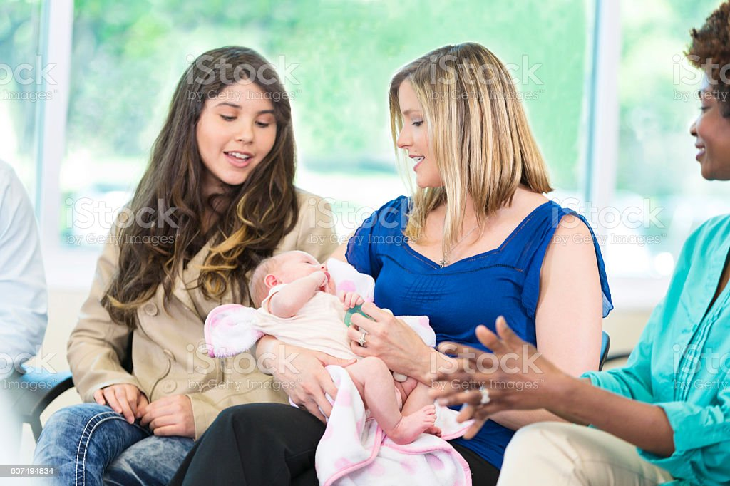 Working mother participates in discussion group stock photo