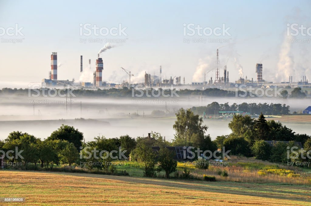 Working Nitrogen Plant in smoke in summer morning. stock photo