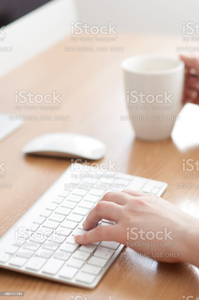 Working on a Apple iMac computer. stock photo