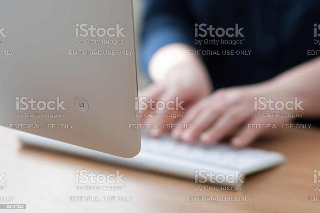 Working on a Apple iMac computer stock photo