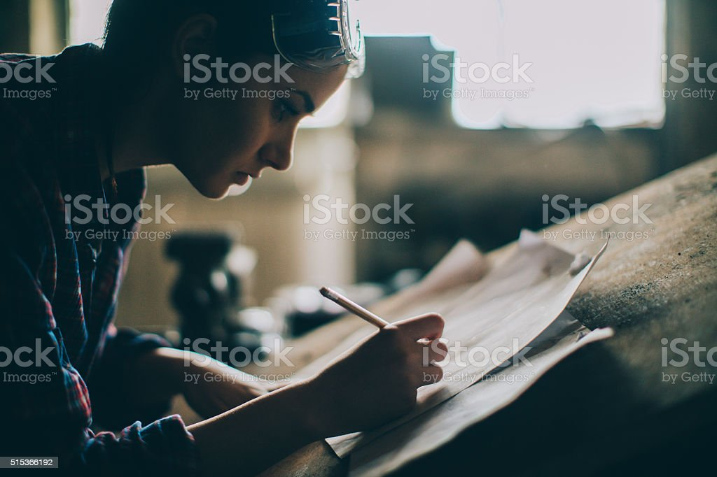Working on a blueprint royalty-free stock photo