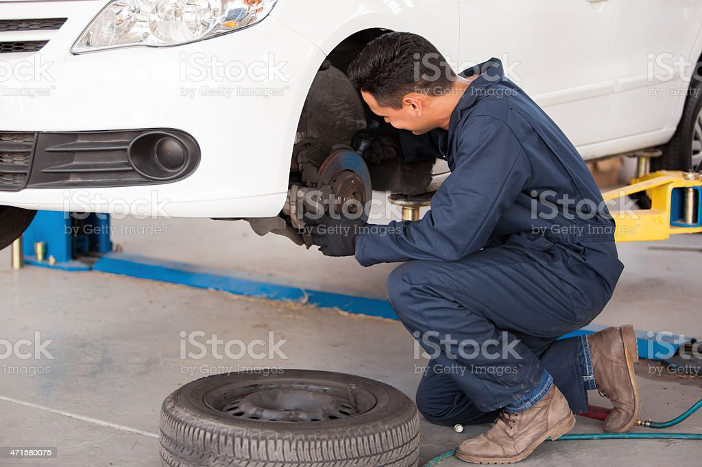 Working on a car brakes stock photo