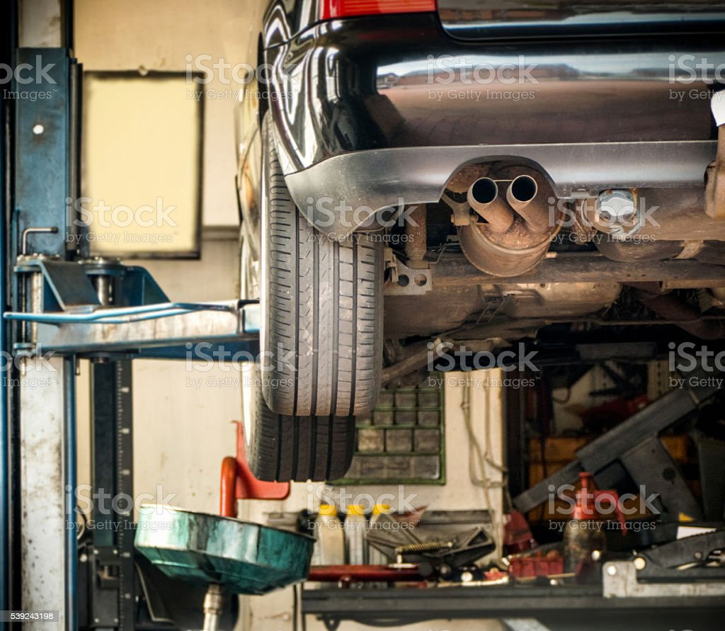 working on a chassis in auto repair shop royalty-free stock photo