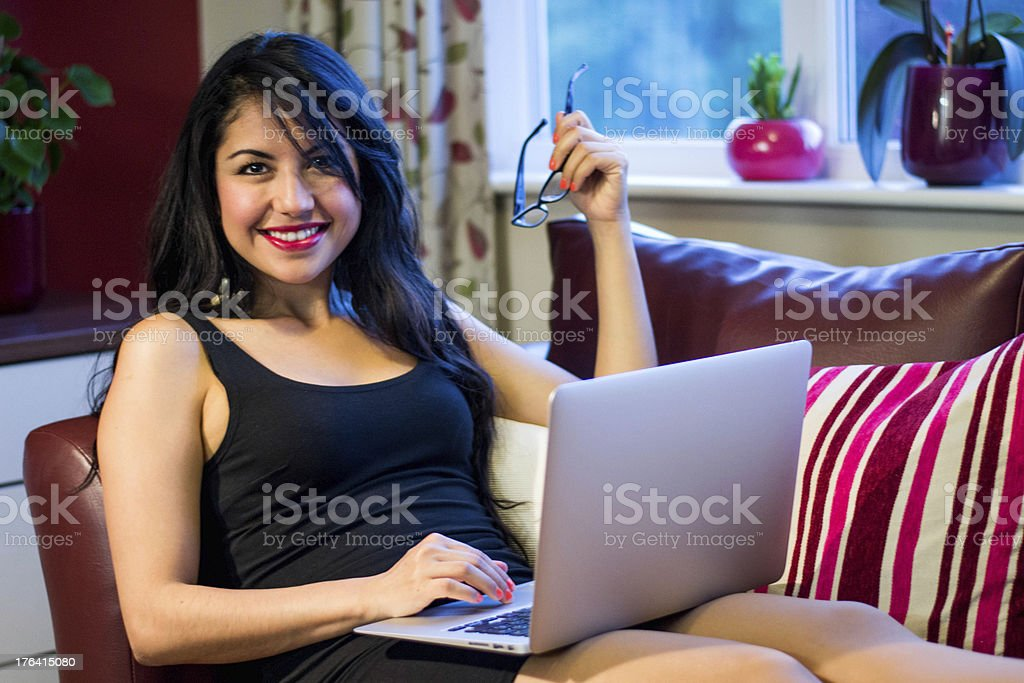 Working on a couch at home royalty-free stock photo