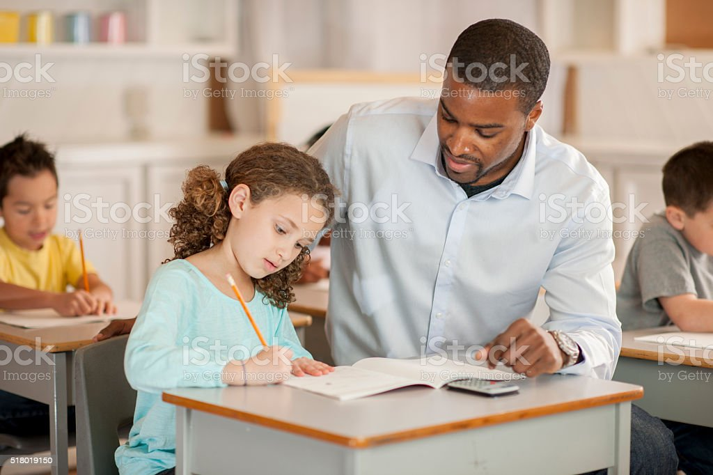 Working on a Math Assignment stock photo