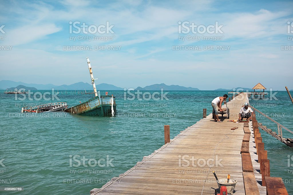 Working on a pier. royalty-free stock photo