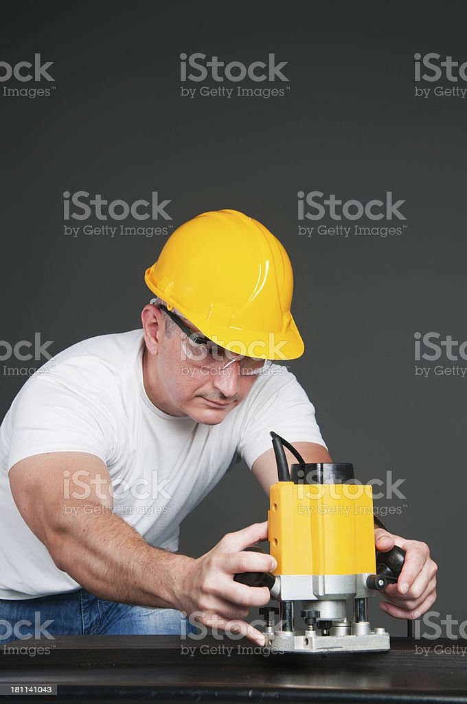 Working on a plank royalty-free stock photo