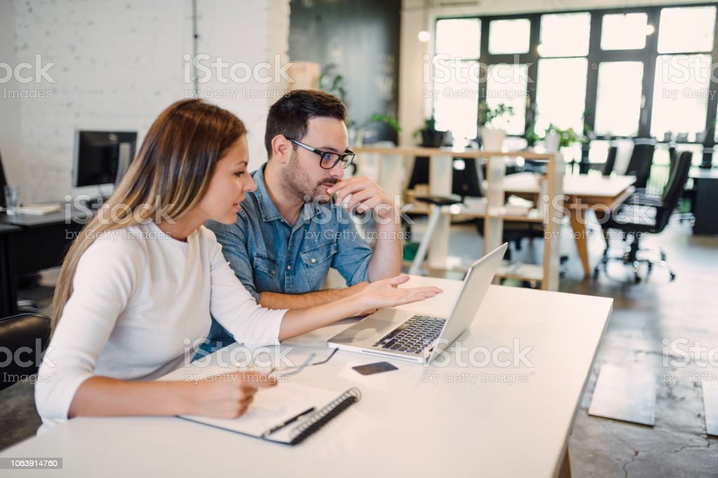 Working on a project in creative studio. stock photo