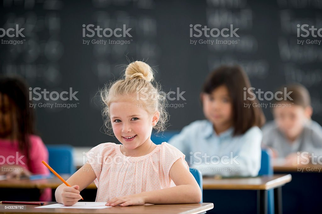 Working on a Writing Assignment stock photo