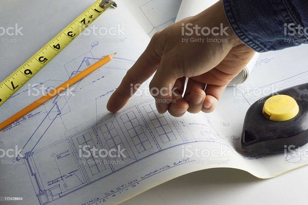 Working on Building Plan royalty-free stock photo