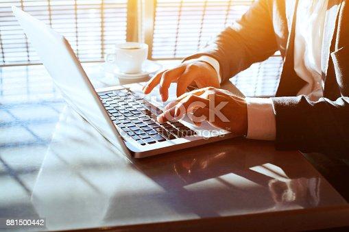 istock working on computer laptop online, closeup of hands of businessman 881500442
