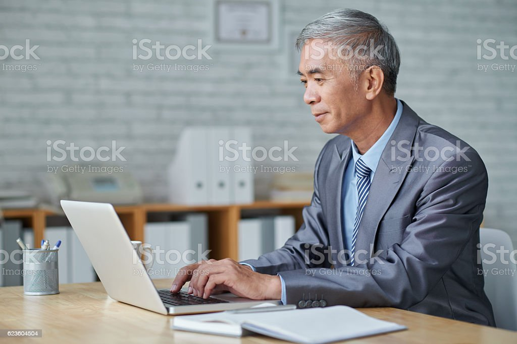 Working on computer stock photo