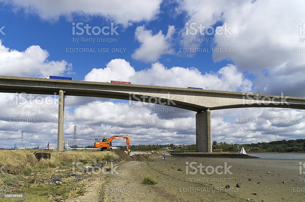 Working on flood defences by the River Orwell royalty-free stock photo