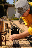 Man working on his garden railroad