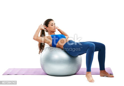 Shot of a sporty young woman practising yoga against a white background