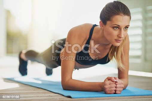 istock Working on her core 623619166