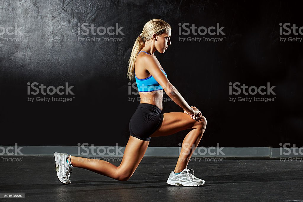 Working on her legs stock photo