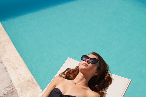Working On Her Tan Stock Photo - Download Image Now