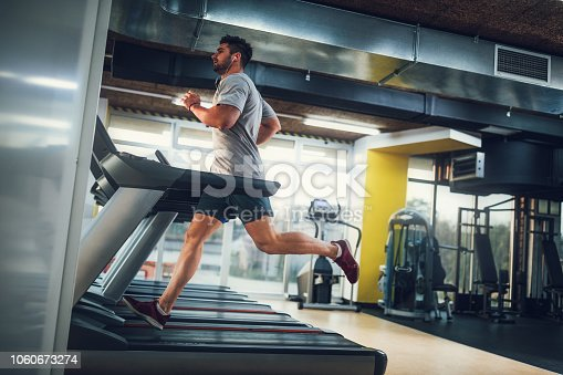 Male running on treadmill at the gym