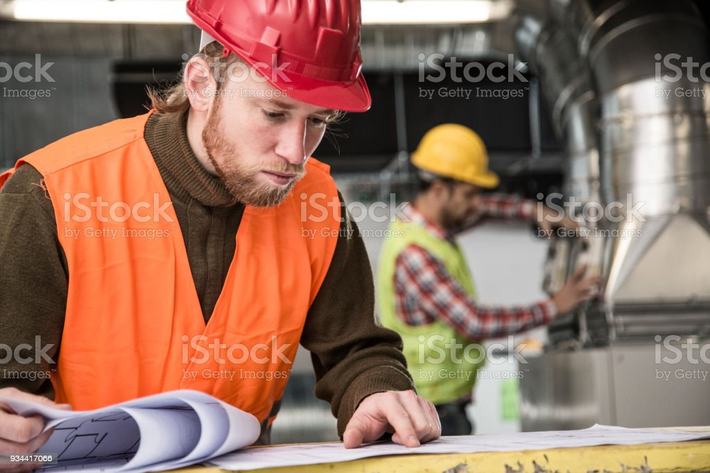 Working on HVAC system stock photo