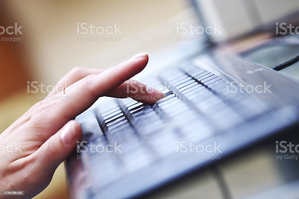 working on keyboard royalty-free stock photo