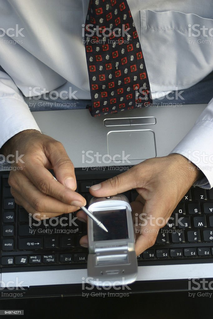 working on laptop and mobile royalty-free stock photo