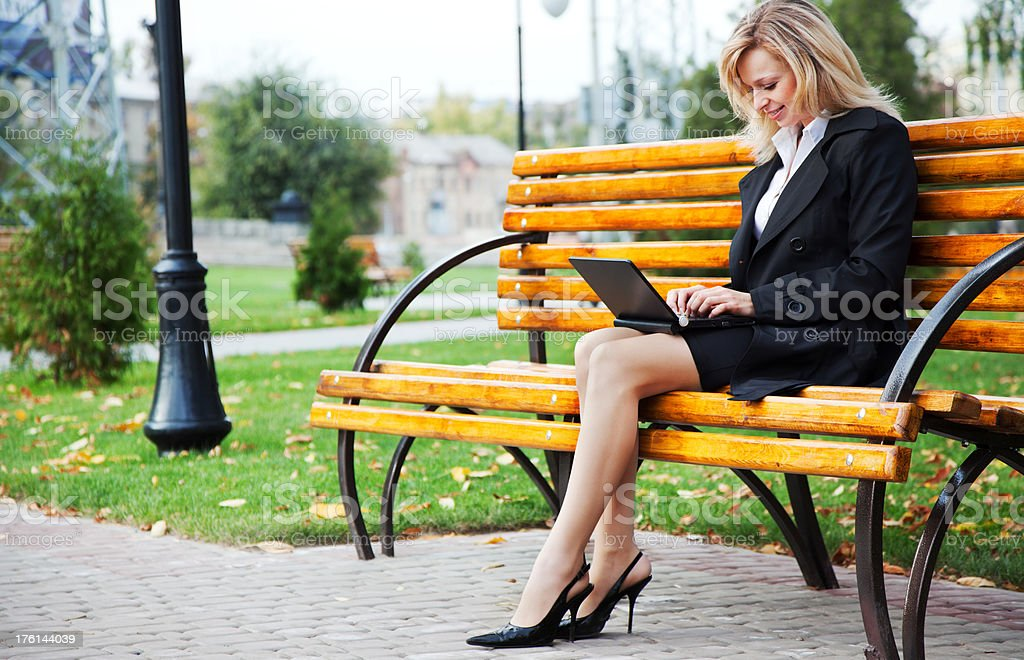 Working on laptop at the park royalty-free stock photo
