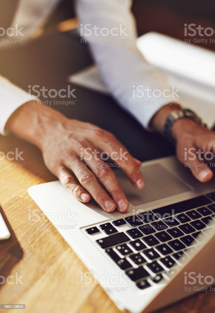Working on laptop, close up of business man stock photo