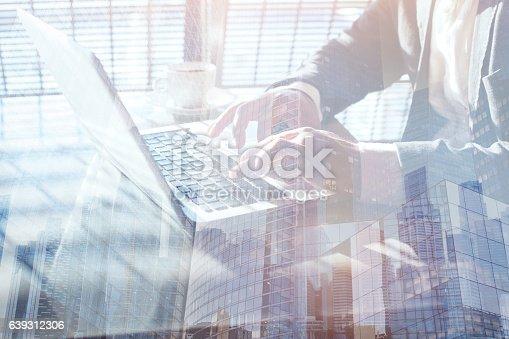 istock working on laptop computer, double exposure of hands 639312306